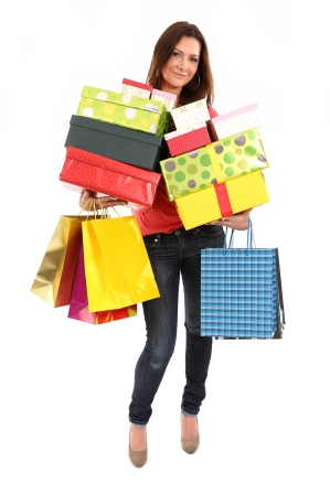 Happy woman with shopping bags and gifts