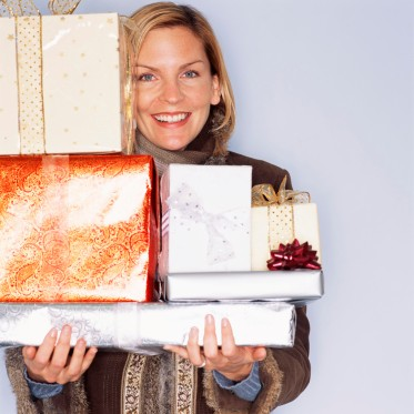 Woman Holding Pile of Wrapped Presents